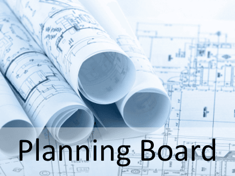 planning board with rolled up plans